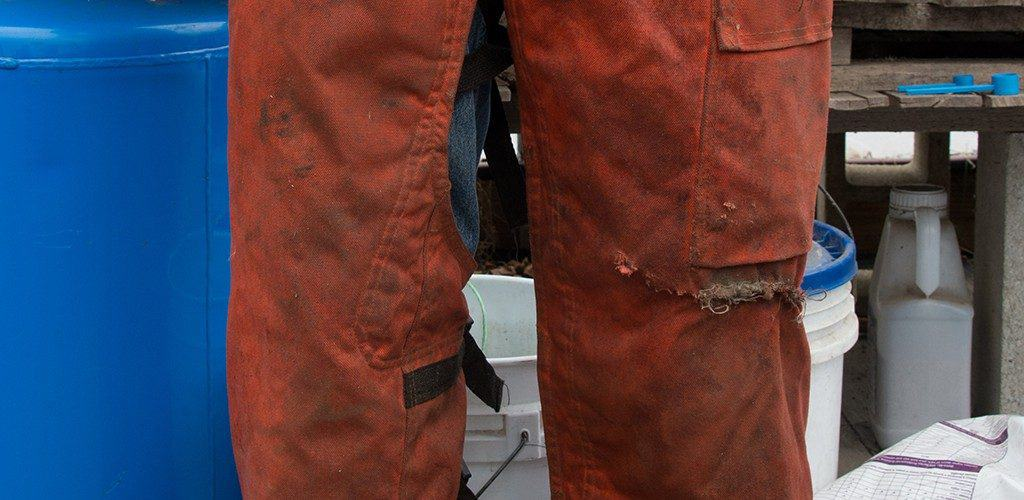 man wearing chainsaw chaps
